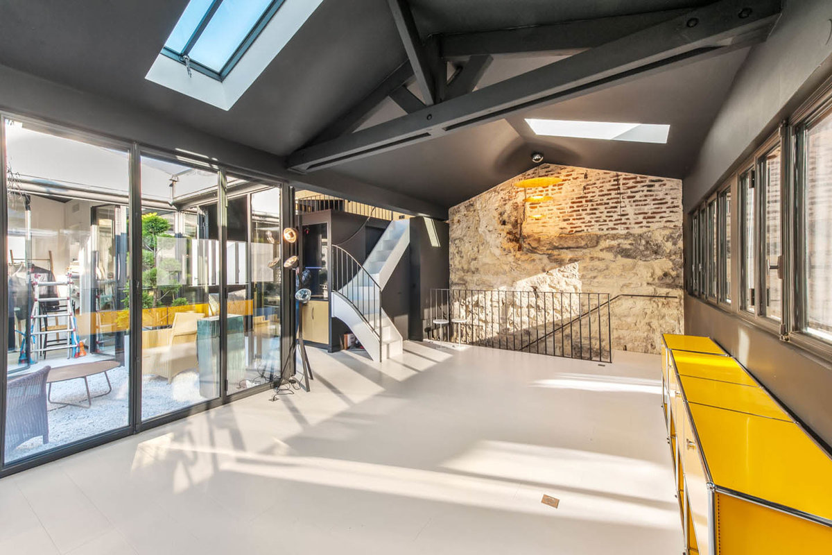 Storefront listing fabulous apartment near louvre museum paris france