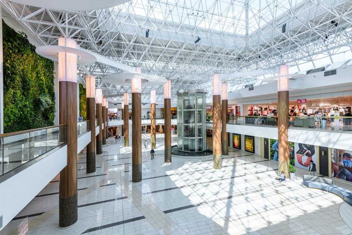 Storefront listing Premiere, high-traffic atrium space at Guildford Town Centre in Guildford, Surrey, Canada.