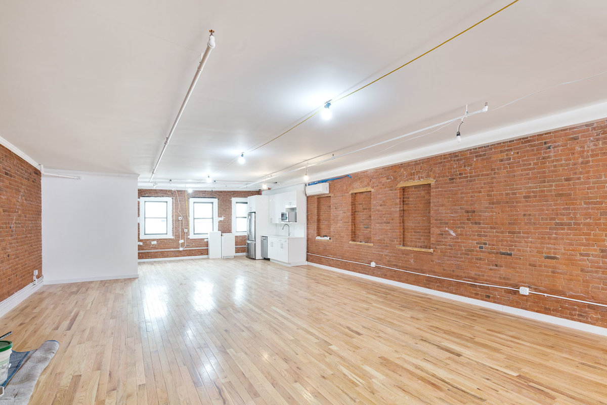 Storefront listing Loft Space in Bowery in Lower Manhattan, New York, United States.