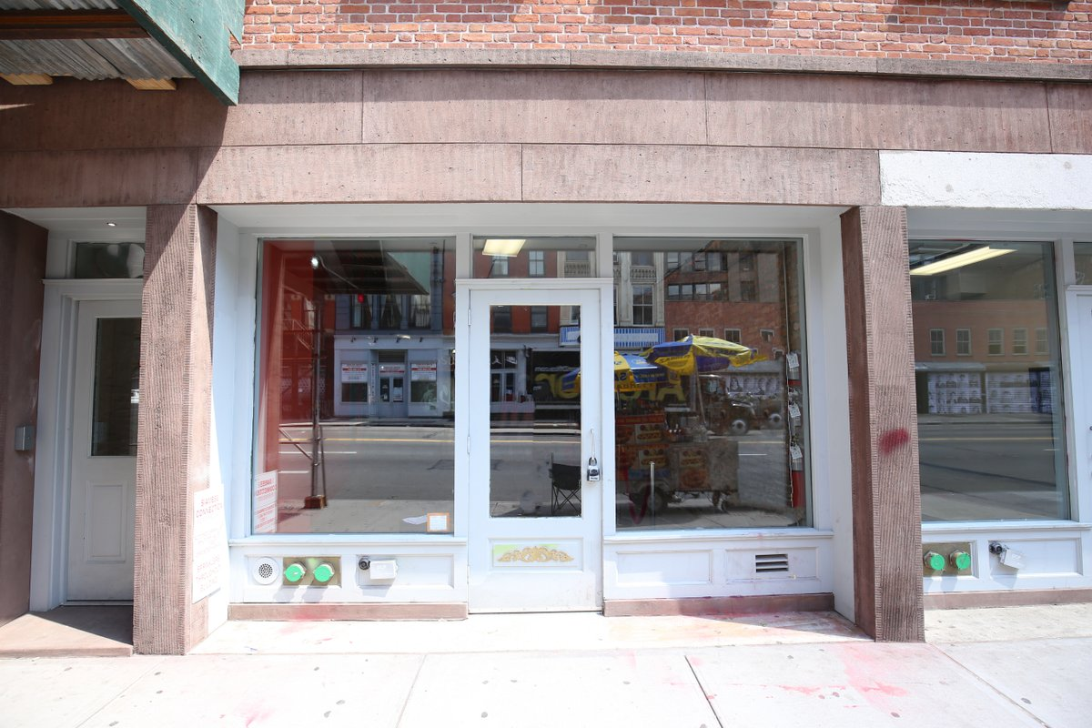 Storefront listing Pop-Up Boutique on Canal Street in SoHo, New York, United States.