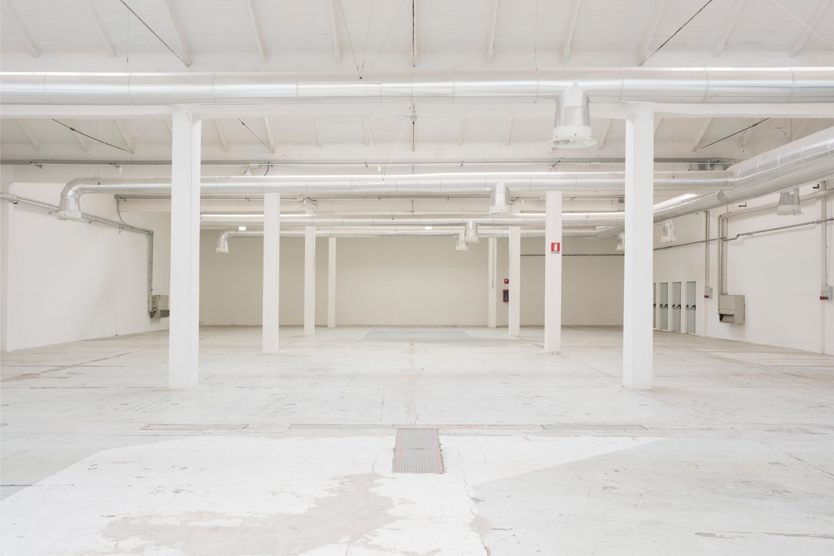 Storefront listing High-scale Industrial Event Space in Navigli Area, Milan, Italy.