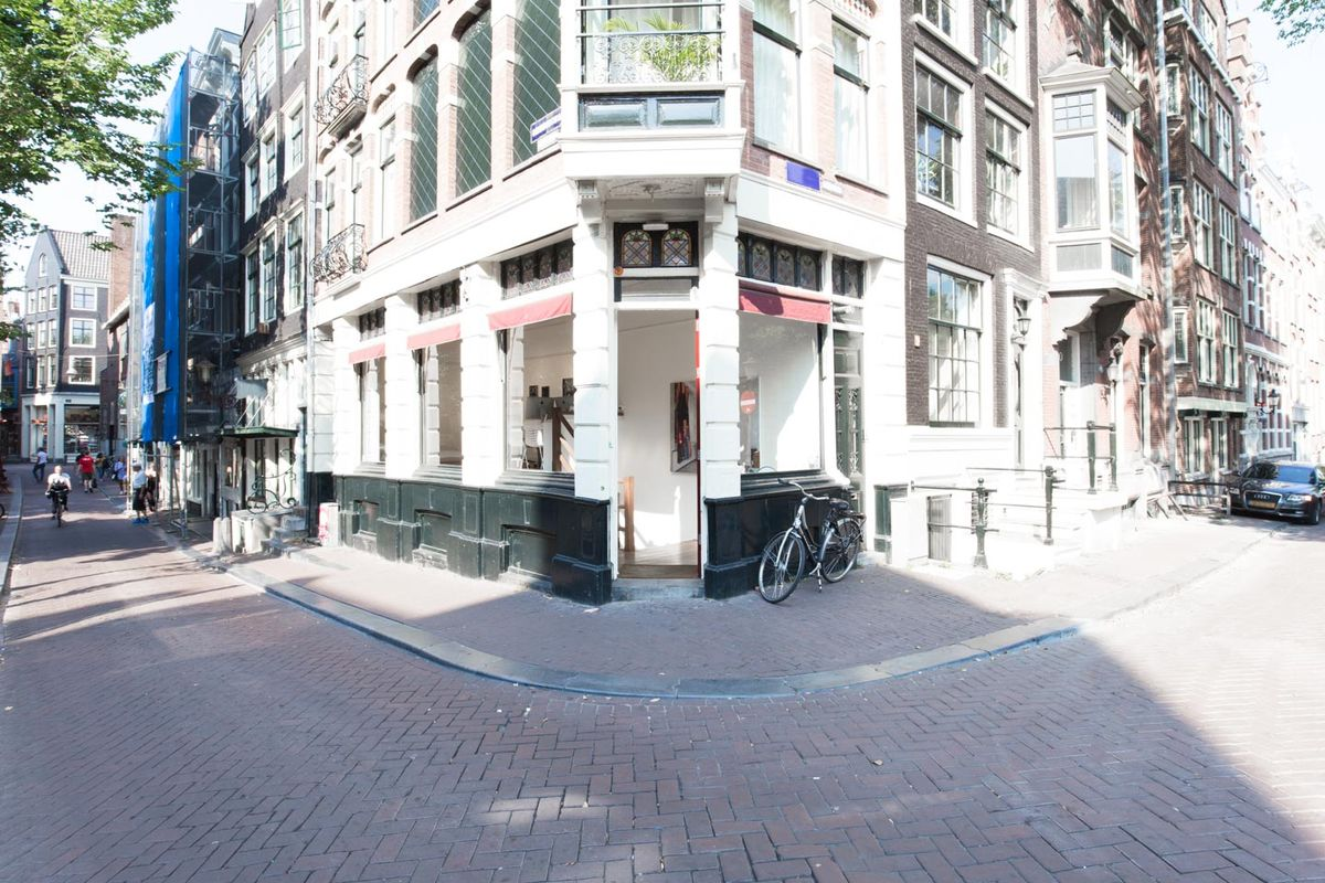Storefront listing Sleek Art Gallery in The Center in Historic City Center, Amsterdam, Netherlands.