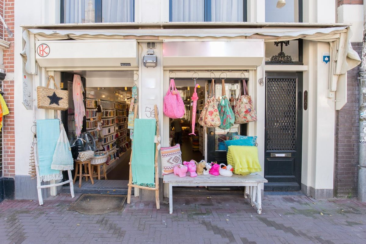 Storefront listing Modern Boutique on the border between Jordaan and the Canal Ring, Amsterdam, Netherlands.